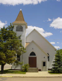A white church with steps to the door